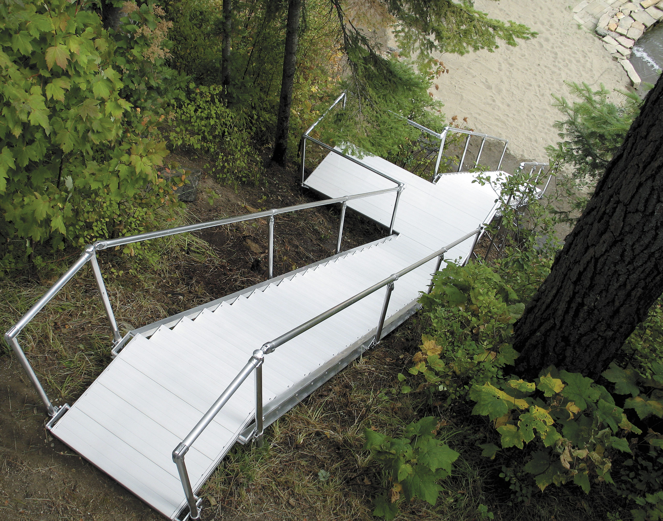 aluminum stairs on steep incline to water